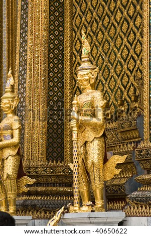 guards of the temple Wat Phra Kaeo in the  Grand Palace in bangkok, Thailand