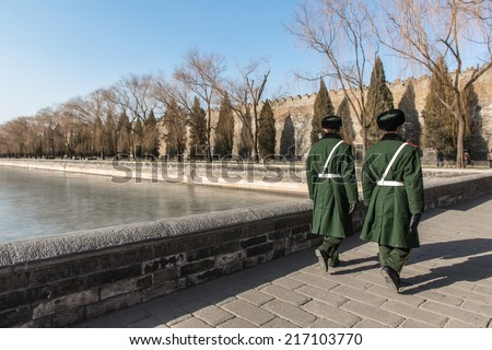 guards patrolling outside forbidden city in beijing, china