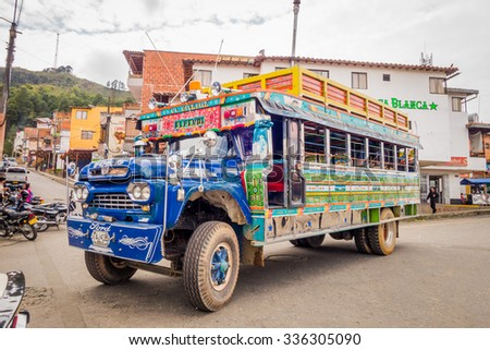 GUATAPE, COLOMBIA - FEBRUARY 7, 2015: Colorful old public bus, chiva, in Guatape