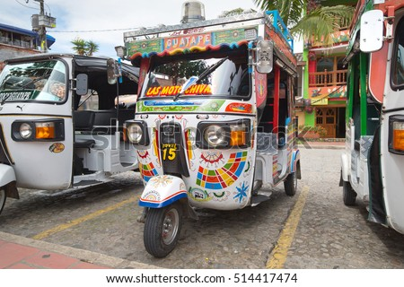 GUATAPE, COLOMBIA - OCTOBER 11, 2016: Moto taxi on the colorful streets and decorated houses of Guatape city near Medellin, Antioquia, Colombia