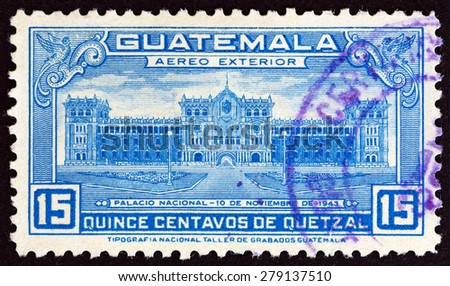 GUATEMALA - CIRCA 1944: A stamp printed in Guatemala issued for the Inauguration of National Palace shows National Palace, circa 1944. - stock photo