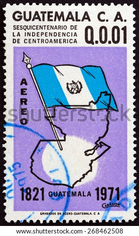 GUATEMALA - CIRCA 1971: A stamp printed in Guatemala issued for the 150th anniversary of Central American Independence shows flag and map, circa 1971. - stock photo
