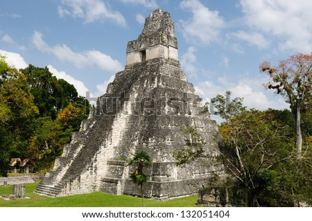 Guatemala, Mayan ruins in the jungle in Tikal. The picture presents Temple I on the Plaza Grande - stock photo