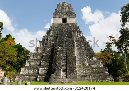 Guatemala, Mayan ruins in the jungle in Tikal. The picture presents Temple I on the Plaza Grande, Central America - stock photo