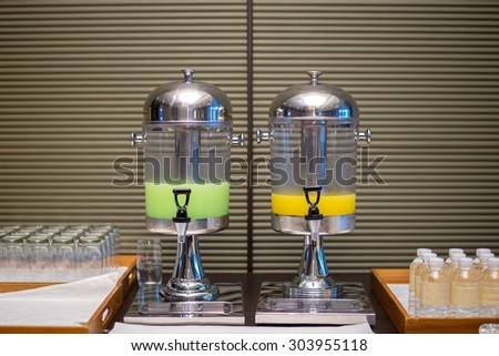 Guava and Orange juice in water cooler for guess of seminar in the hotel - stock photo