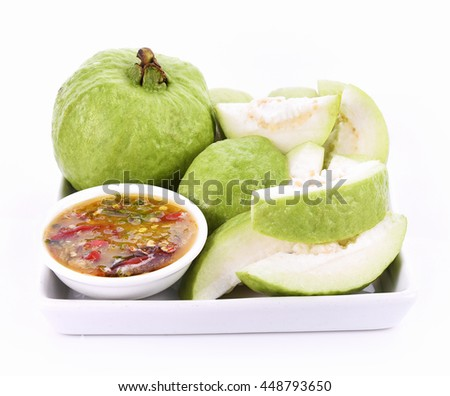 Guava fruit and Salt, pepper, dip fruit on white background