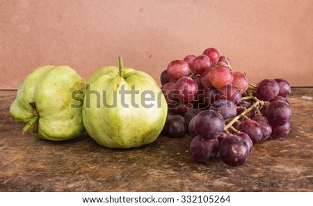 guava grapes on the table wood - stock photo