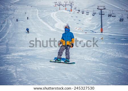 GUDAURI, GEORGIA - DECEMBER 25, 2014 - Snowboarder in winter resort Gudauri, Georgia, Caucasus mountains. - stock photo