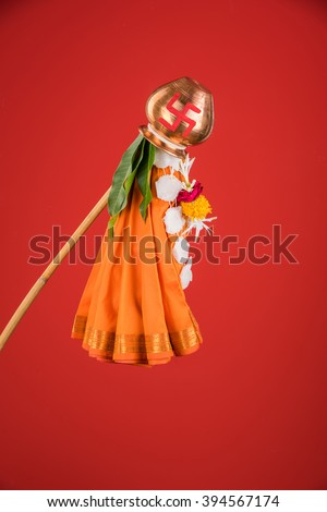 gudi or gudhi, errected on gudhi padwa or gudhi padwa. Gudi Padwa is a hindu or marathi new year. Isolated on red background - stock photo