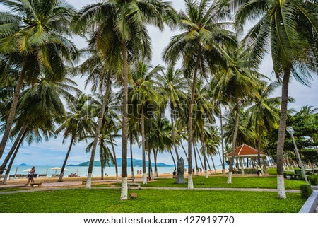 guest houses among palm trees, Southern Vietnam - stock photo