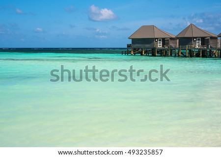 Guest houses on the ocean with space for text