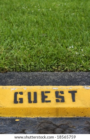 Guest parking curb on a parking lot - stock photo