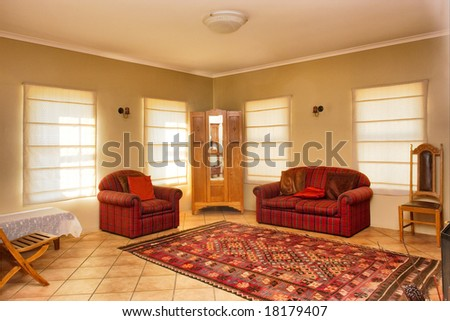 Guest room with red sofas in townhouse. Shot in Kuils River Winelands, near Stellenbosch/Cape Town, Western Cape, South Africa. - stock photo
