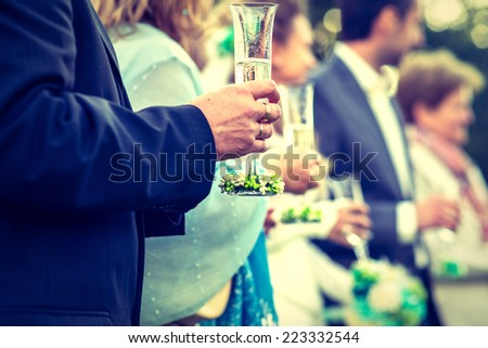 Guests drink champagne on the wedding ceremony - stock photo
