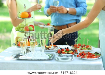 Guests drink champagne on wedding ceremony - stock photo