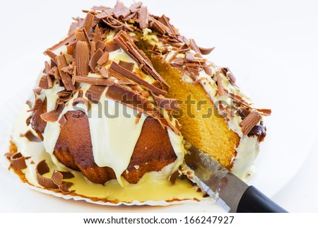 gugelhupf cake with chocolate sprinkles isolated on white background