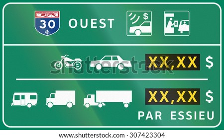 Guide and information road sign in Quebec, Canada - Fees for different vehicle types. Translations: Ouest - West, Par essieu - Per axle - stock photo