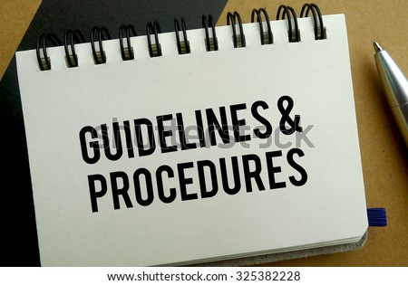 Guidelines and procedures memo written on a notebook with pen - stock photo