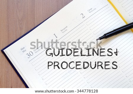 Guidelines and procedures text concept write on notebook with pen