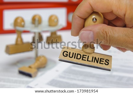 guidelines marked on rubber stamp in hand - stock photo