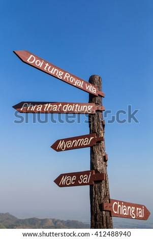 """Guidepost use to point the direction of many place.""""Myanmar"""" is the country near Thailand. """"Other names"""" are the tourist attraction in Thailand - stock photo"""