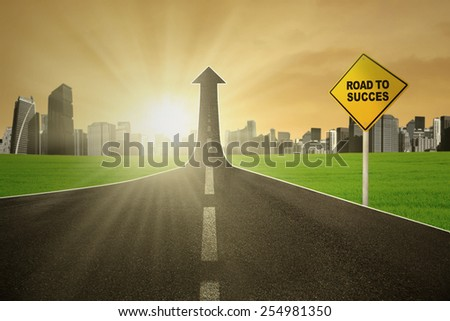 Guidepost with showing the road to success turning into arrow upward with bright sunrise - stock photo
