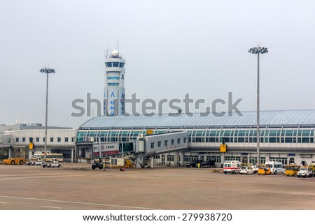 GUILIN, CHINA - APR 30, 2015: Main terminal building and traffic control tower of Guilin Liangjiang International Airport. In 2014, it was the 33rd busiest airport in China with 5875327 people. - stock photo