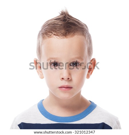 Guilty and upset small kid on isolated white