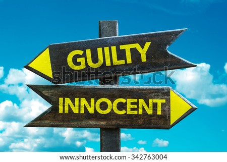 Guilty - Innocent signpost with sky background - stock photo