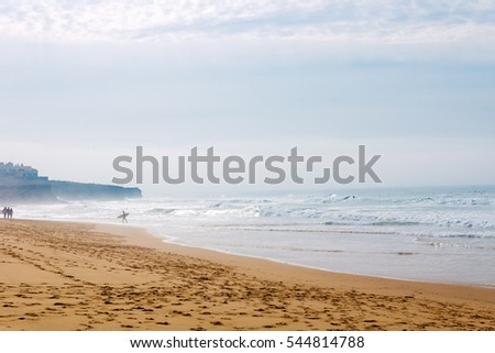 Guincho Beach in the fog in autumn in sunny weather near Lisbon in Portugal
