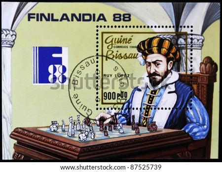 GUINEA BISSAU - CIRCA 1988: A stamp printed in Guinea Bissau shows costumed man playing chess, circa 1988