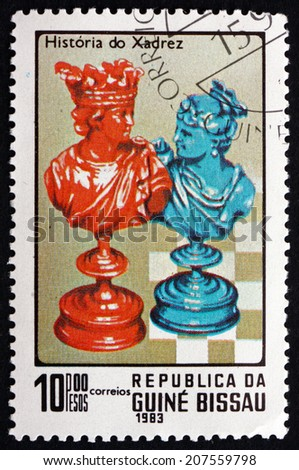 GUINEA-BISSAU - CIRCA 1983: a stamp printed in the Guinea-Bissau shows King and Queen, Chess Pieces, circa 1983 - stock photo