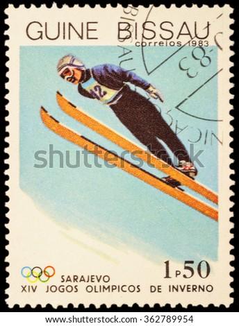 GUINEA-BISSAU - CIRCA 1983: stamp printed in Guinea-Bissau shows ski jumping, devoted to Winter Olympics in Sarajevo, circa 1983 - stock photo