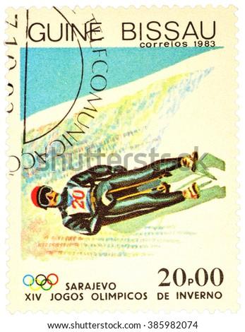 GUINEA-BISSAU - CIRCA 1983: stamp printed in Guinea-Bissau shows toboggan, devoted to the 14th Winter Olympics in Sarajevo, series, circa 1983 - stock photo