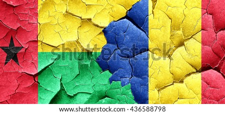 Guinea bissau flag with Romania flag on a grunge cracked wall