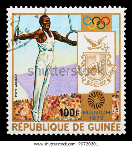 GUINEA - CIRCA 1972: A stamp printed in GUINEA shows track and field, series Olympic games in Munich, circa 1972