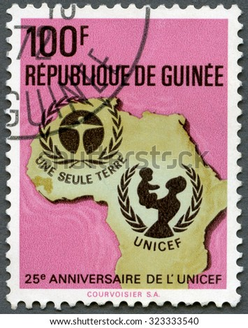 GUINEA - CIRCA 1971: A stamp printed in Republic of Guinea shows UNICEF Emblem, Map of Africa, series 25th anniversary, circa 1971 - stock photo