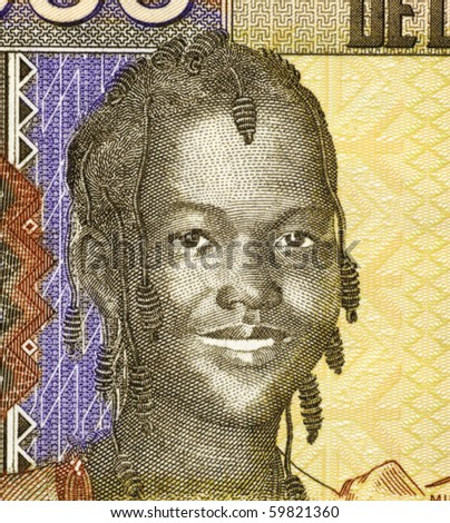 GUINEA - CIRCA 2006: Girl on 1000 Francs 2006 Banknote from Guinea, CIRCA 2006