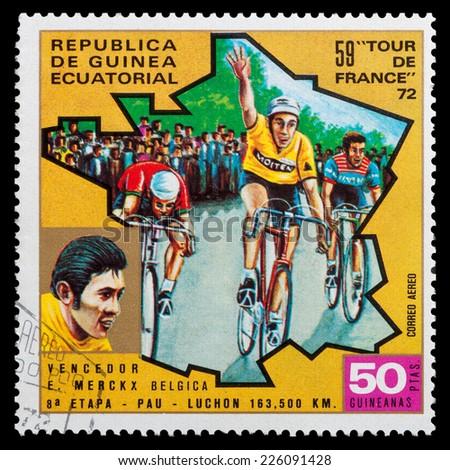 "GUINEA - CIRCA 1972: stamp printed in Guinea shows cyclists and portrait of Edouard Louis Joseph Merckx, series ""59 Tour de France, 1972"", circa 1972 - stock photo"