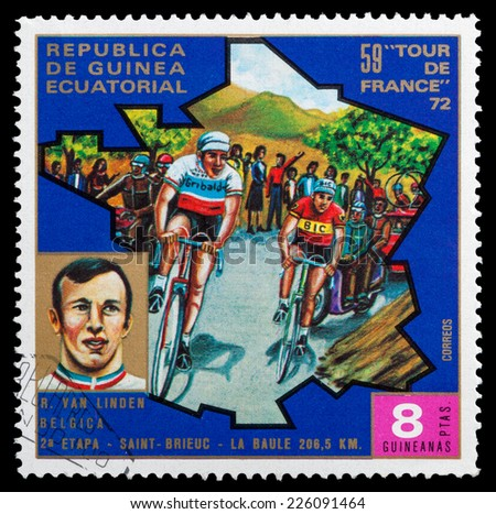 """GUINEA - CIRCA 1972: stamp printed in Guinea shows cyclists and portrait of R. Van Linden, series """"59 Tour de France, 1972"""", circa 1972 - stock photo"""