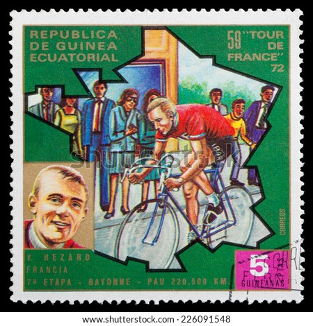 """GUINEA - CIRCA 1972: stamp printed in Guinea shows cyclists and portrait of Y. Hezard, series """"59 Tour de France, 1972"""", circa 1972 - stock photo"""