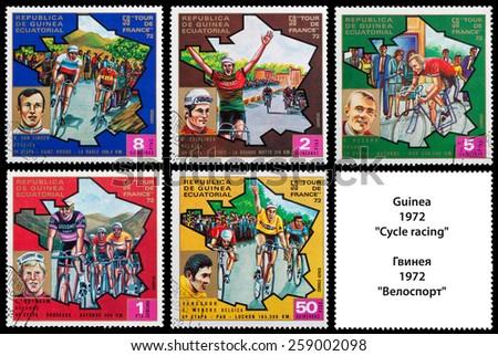 "GUINEA - CIRCA 1972: stamp printed in Guinea shows cyclists, series ""59 Tour de France, 1972"", circa 1972 - stock photo"