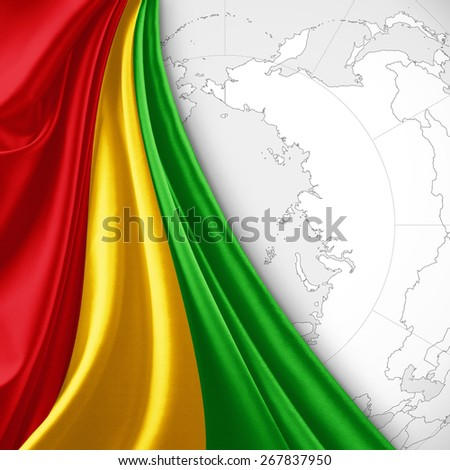 Guinea flag and world map background - stock photo