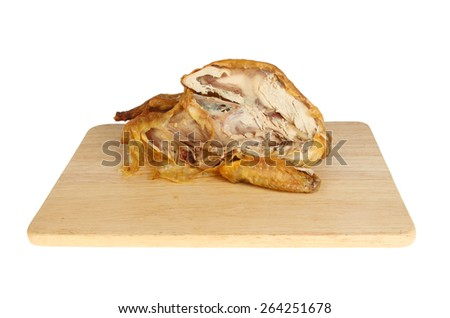 Guinea fowl carcass on a wooden board isolated against white - stock photo