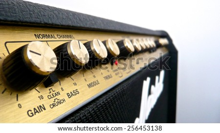 Guitar amp golden knobs - stock photo