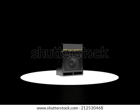 Guitar amp stands on the podium and is highlighted below - stock photo