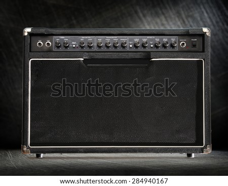 Guitar amplifier on black steel scratchy background