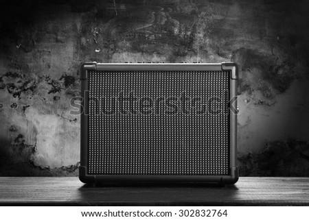 Guitar amplifier on dark background - stock photo