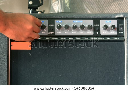 guitar and amplifier control - stock photo