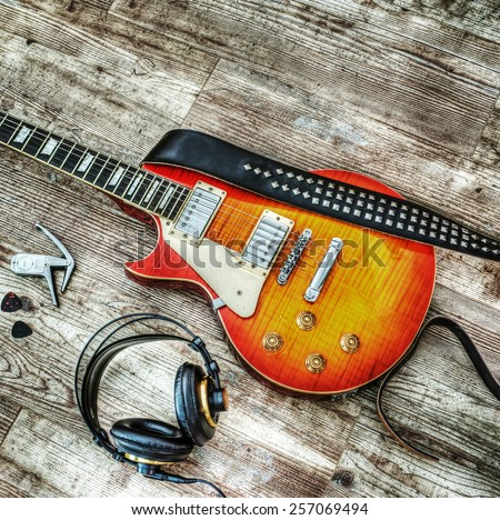 guitar and headphones in hdr tone mapping effect - stock photo
